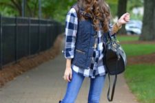 With plaid shirt, jeans and high boots