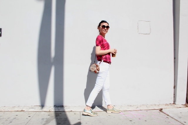 With plaid shirt, white jeans and bag