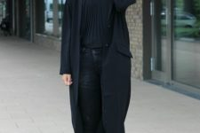With pleated blouse and black jeans