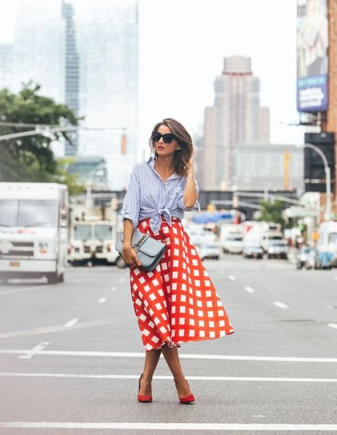 With printed midi skirt and red shoes