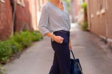 With printed shirt, golden flats and dark blue bag