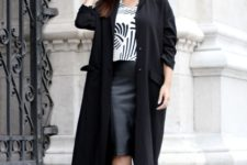 With printed shirt, leather knee-length skirt and pumps