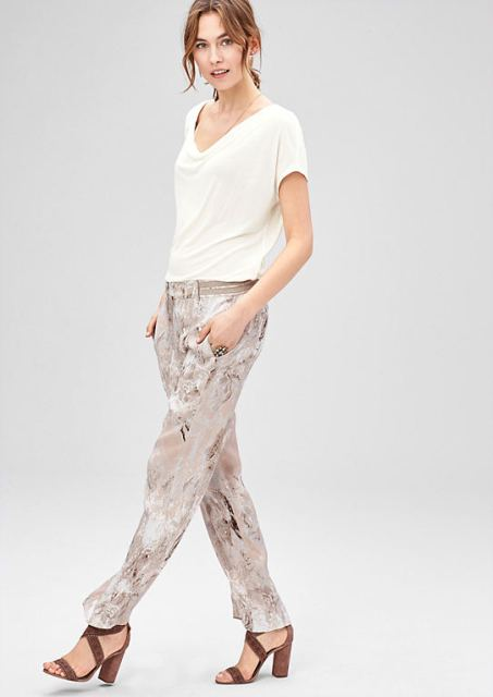 With printed trousers and sandals