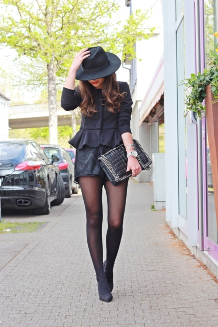 With shorts, hat, clutch and high heels