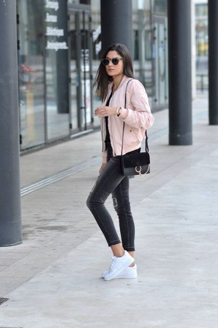 With skinny jeans and white sneakers