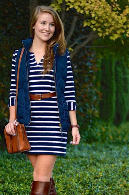 With striped dress, leather belt and bag