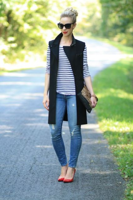 With striped shirt, distressed jeans and red shoes