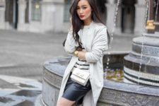 With striped shirt, mini skirt and lace up heels