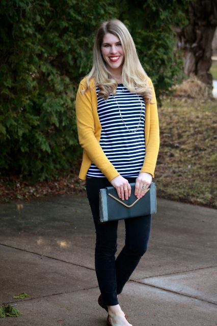 With striped shirt, yellow jacket and clutch