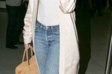 With t-shirt, distressed jeans, camel bag and scarf