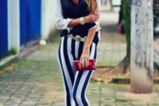 With two color shirt, pumps and clutch