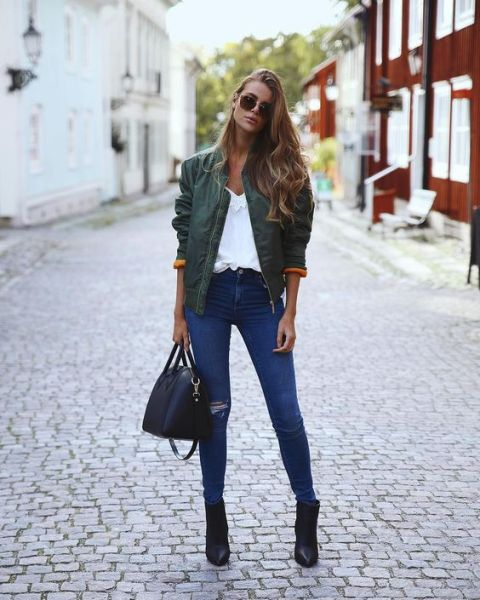 With white blouse, jeans and ankle boots
