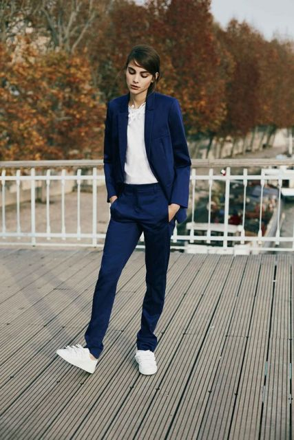 With white blouse, navy blue pants and white sneakers