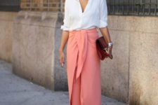 With white blouse, neutral pumps and red clutch