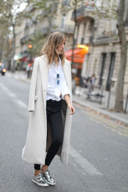 With white blouse, skinny trousers and long coat