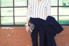 With white button down shirt and white pumps
