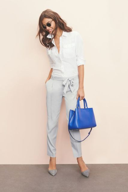 With white classic shirt, gray shoes and bright blue bag