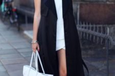 With white mini dress and flat sandals