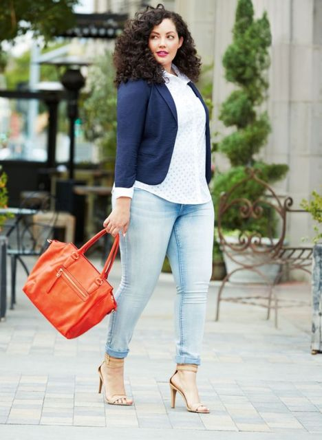 With white shirt, cuffed jeans and red bag