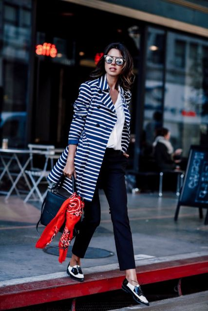 With white shirt, loafers and striped coat