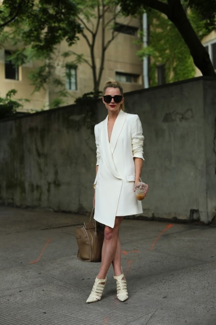 With white shoes and big leather bag