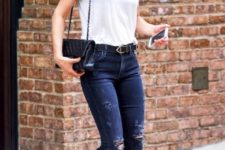 With white t-shirt, distressed jeans and bag with chain strap