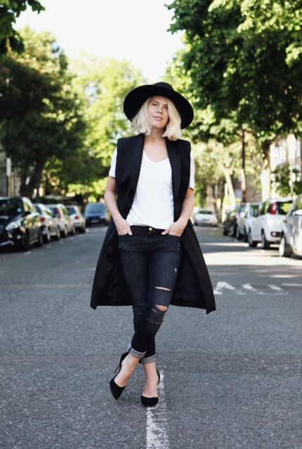 With white t-shirt, skinny jeans and wide brim hat