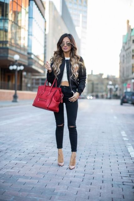With white top, skinny pants and red big bag
