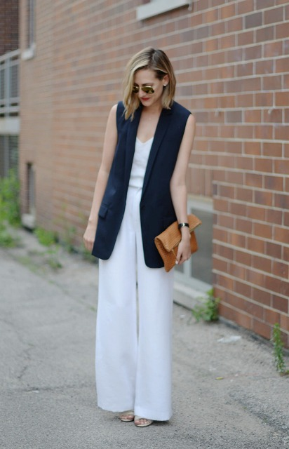 With white wide leg trousers and leather clutch