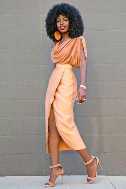With wrapped midi skirt, heels and big earrings