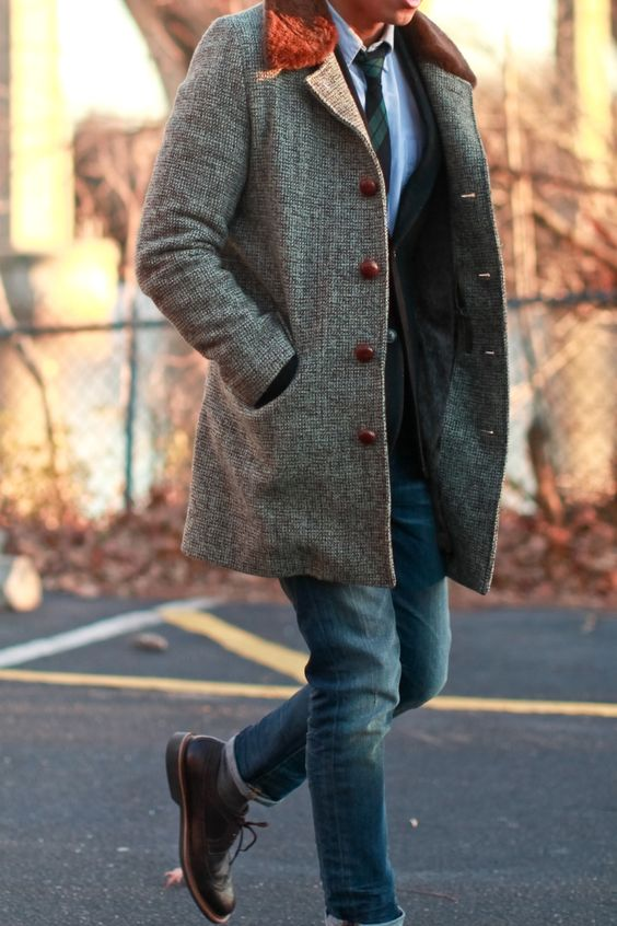 blue jeans, brown boots and a long grey tweed blazer