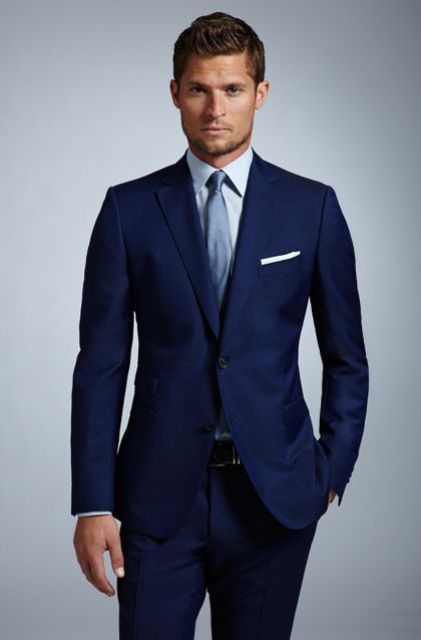 chic navy suit, a light blue shirt and a tie