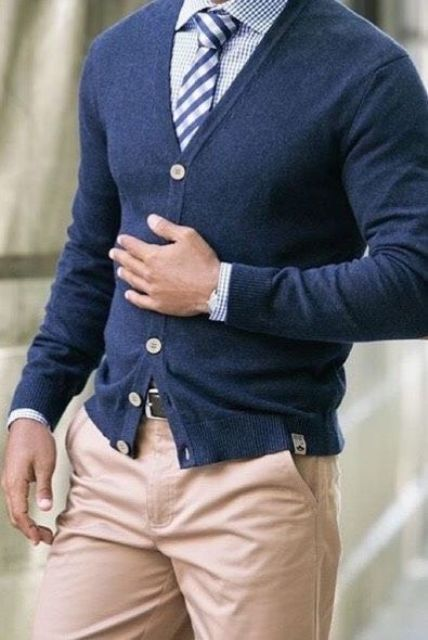 navy cardigan with white buttons paired with a blue gingham shirt and a striped tie