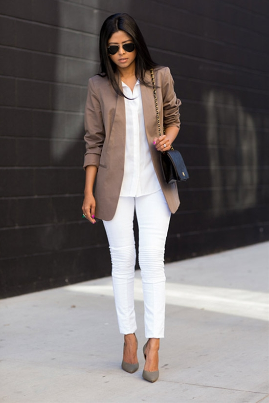 all-white with a tan jacket, grey shoes and a black bag