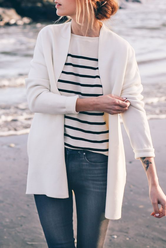 black jeans, a striped shirt and a white cardigan