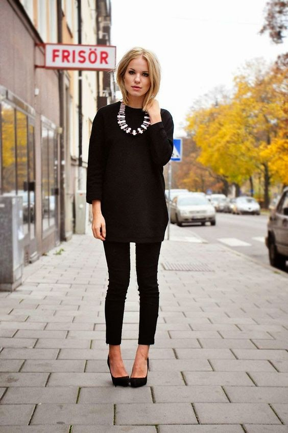 cropped jeans, a sweater and a bib necklace