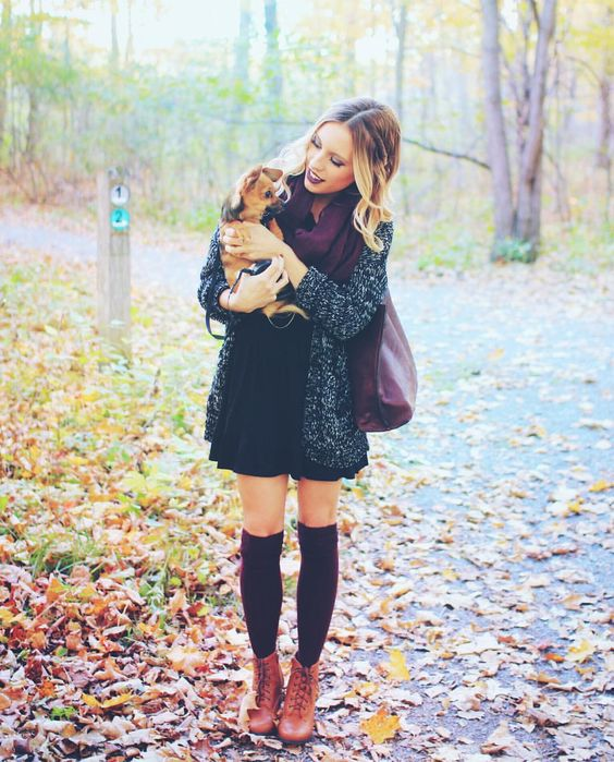 turtleneck sweater dress, a cardigan and burgundy stockings with ankle boots