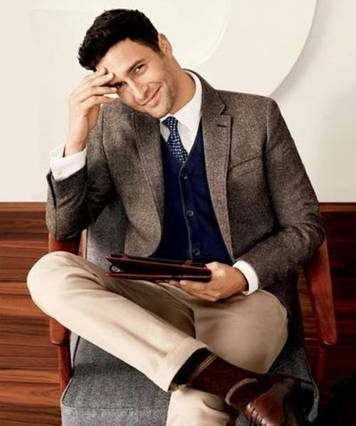 classic look with beige trousers, a navy cardigan and a tweed jacket