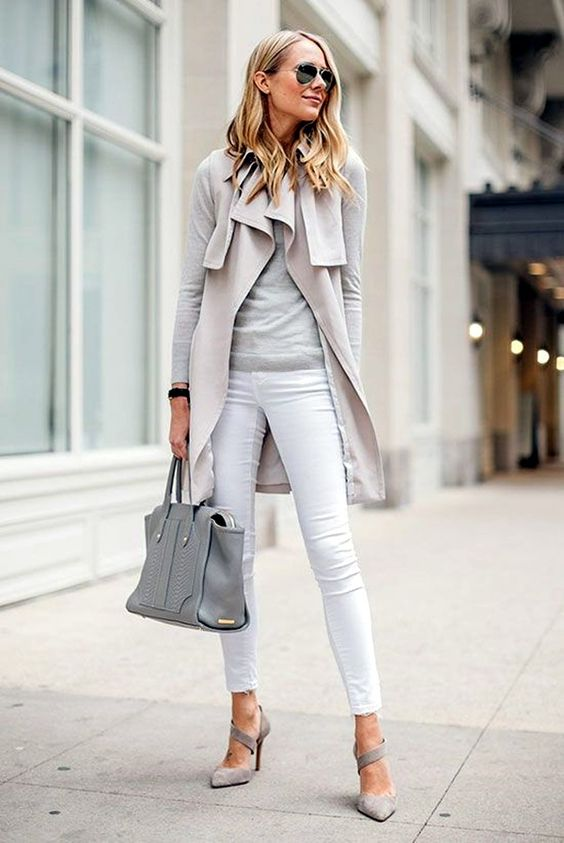 white jeans, a grey sweater and heels, a light grey coat