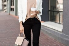 06 black jeans, a tan top, a wwhite blazer and brown suede boots