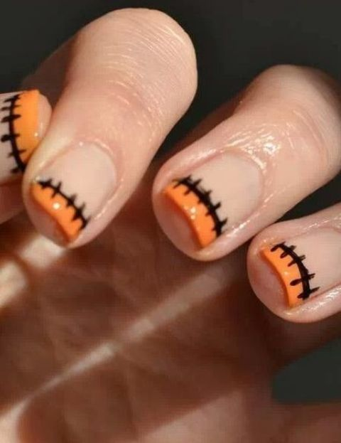French nails with stictches and orange tips