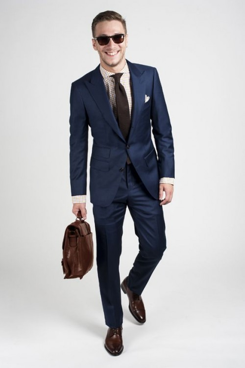 navy suit, brown shoes, a dark brown tie and a patterned shirt