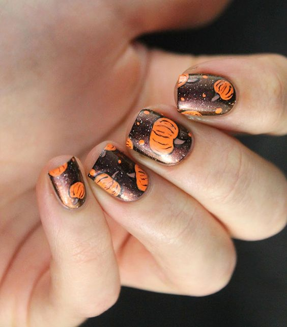 dark brown nails with pumpkins and polka dots