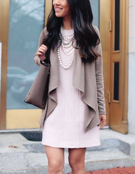 short ruffle cardigan, a blush dress and a strand of pearls are ideal for work