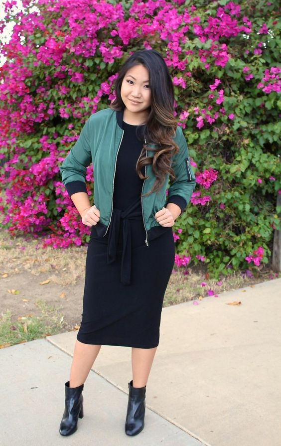 tie-waist bodycon black dress and an olive green bomber jacket