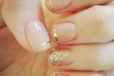 11 French mani with gold striped and a glitter accent nail