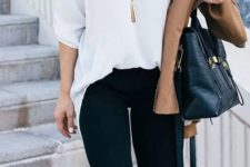 11 black pants, a white shirt tucked in them and leopard heels