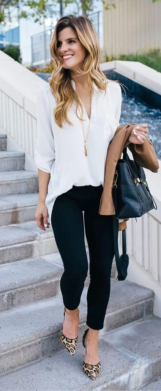 black pants, a white shirt tucked in them and leopard heels