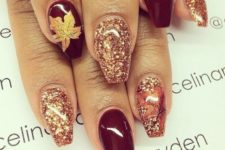 11 burgundy, glitter and maple leaf nails