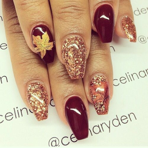 burgundy, glitter and maple leaf nails